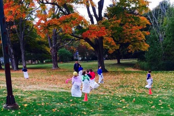 Children in bags in fall